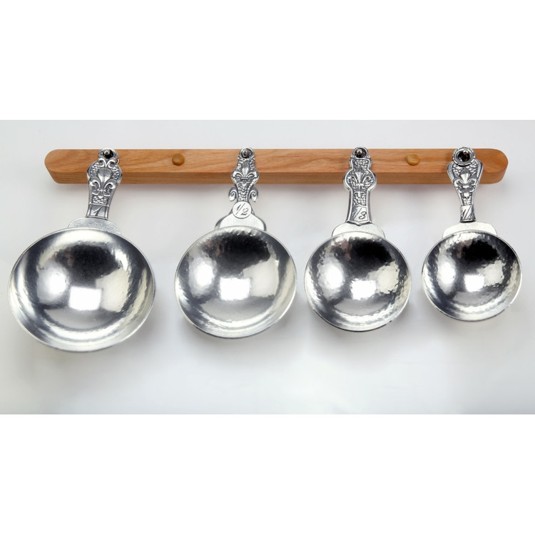 Fleur de Lys Pewter Measuring Cups on Cherry Strip